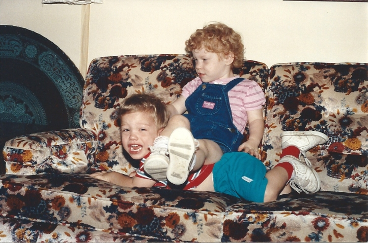 Hannah sitting on Ammon on Gma Gpa Carr couch 19910001